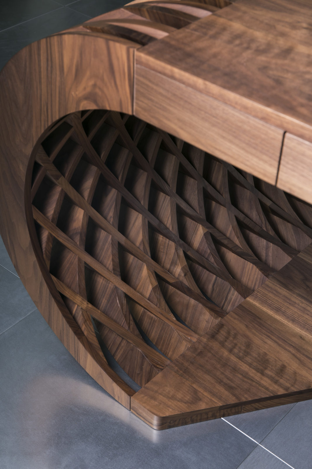 Curved solid walnut desk detail