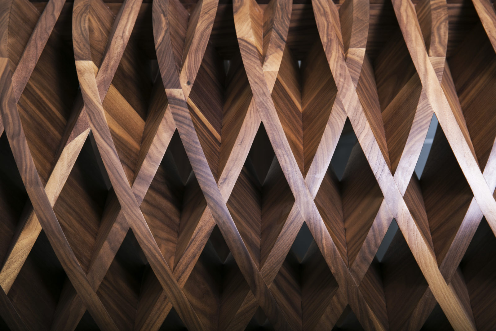Curved solid walnut criss cross pattern close up
