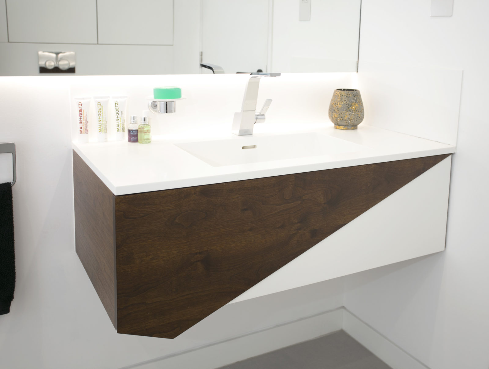 Walnut and Corian vanity unit