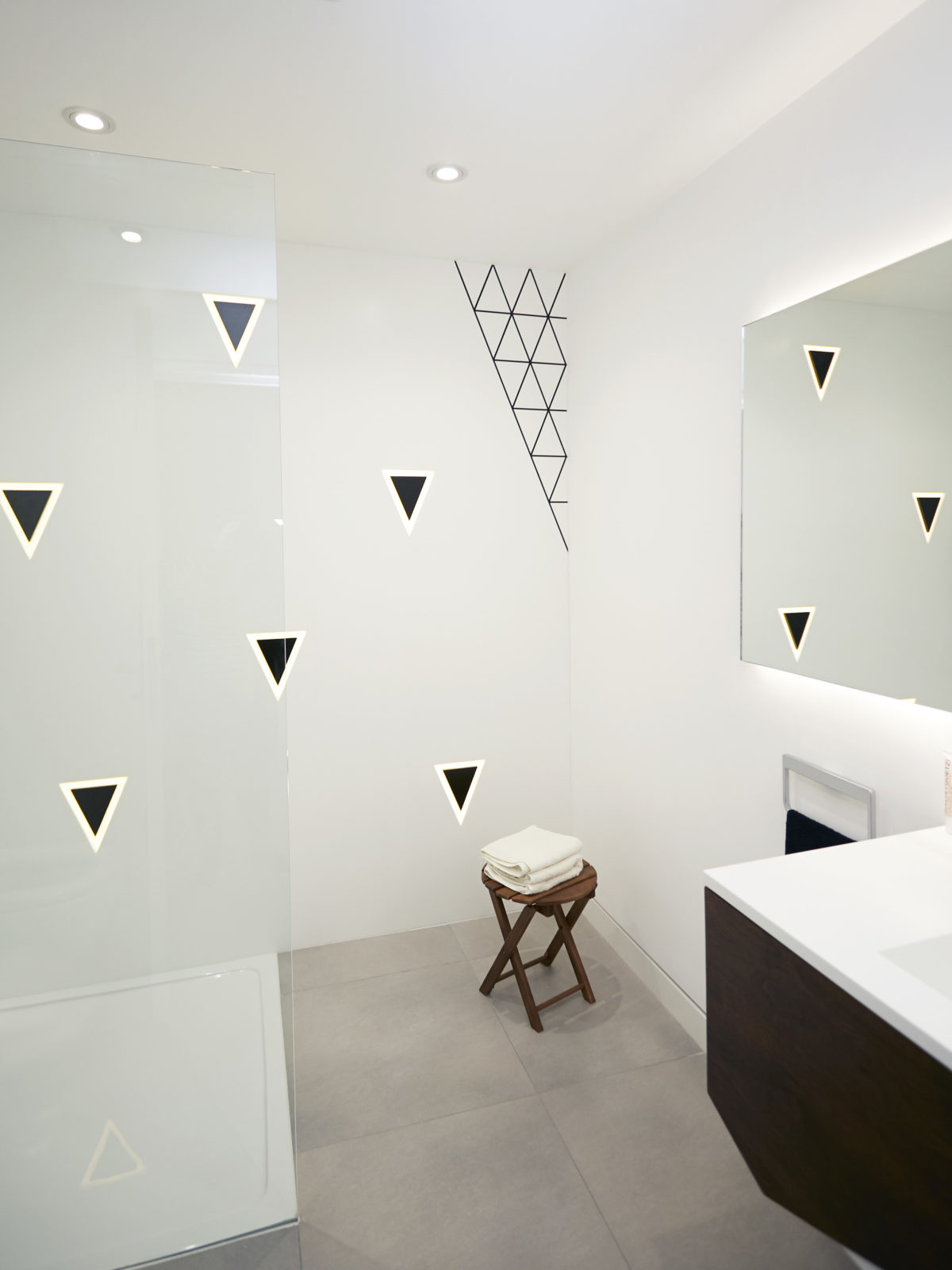 Glacier white backlit corian with black triangle pattern