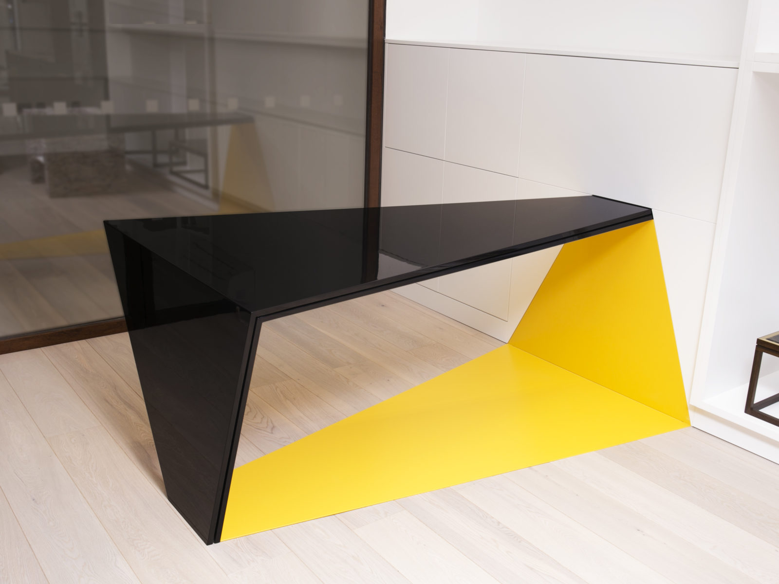 built in yellow lacquered corian and gun metal lacquer desk