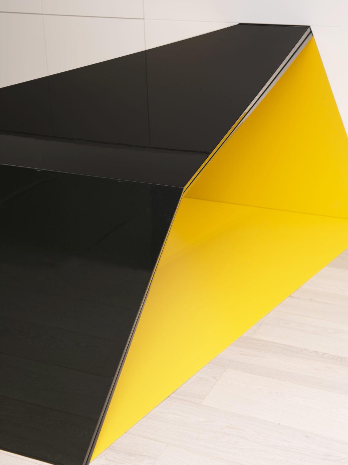 Glossy gun metal lacquered desk with yellow matt lacquered Corian inside