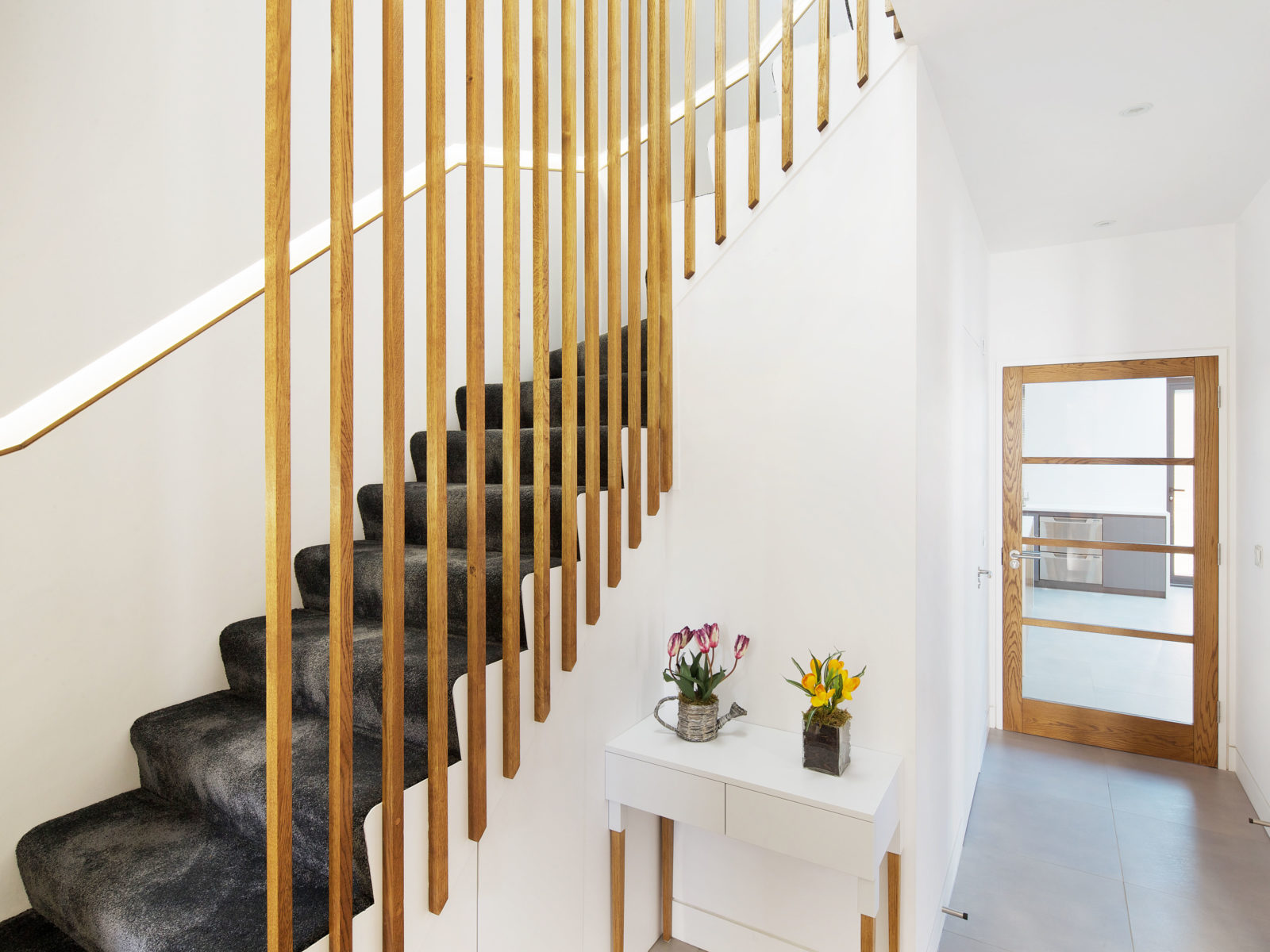 staircase with lighted recessed handrail and oak battens balustrade
