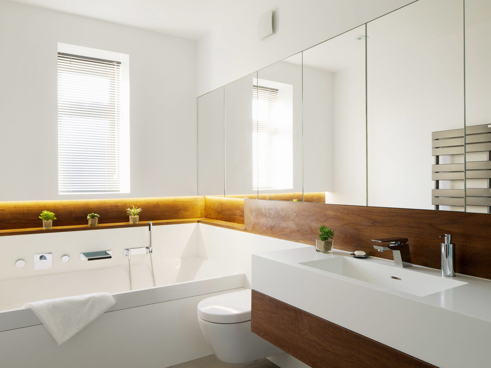 Bathroom with Corian and walnut vanity unit