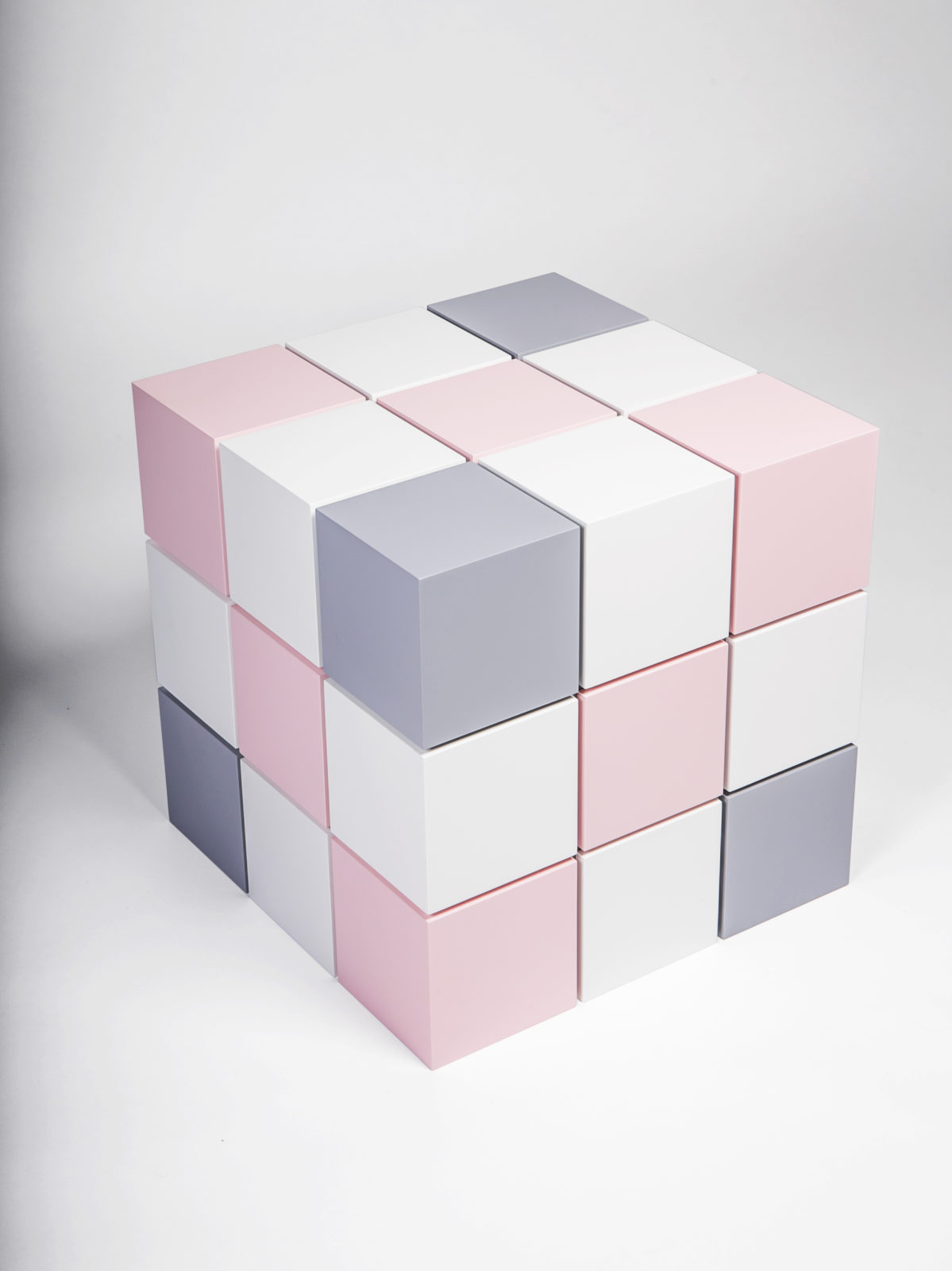 Grey, pink and white matt lacquered cubes