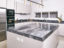 Matt lacquered pantry kitchen with Savana grey marble worktop