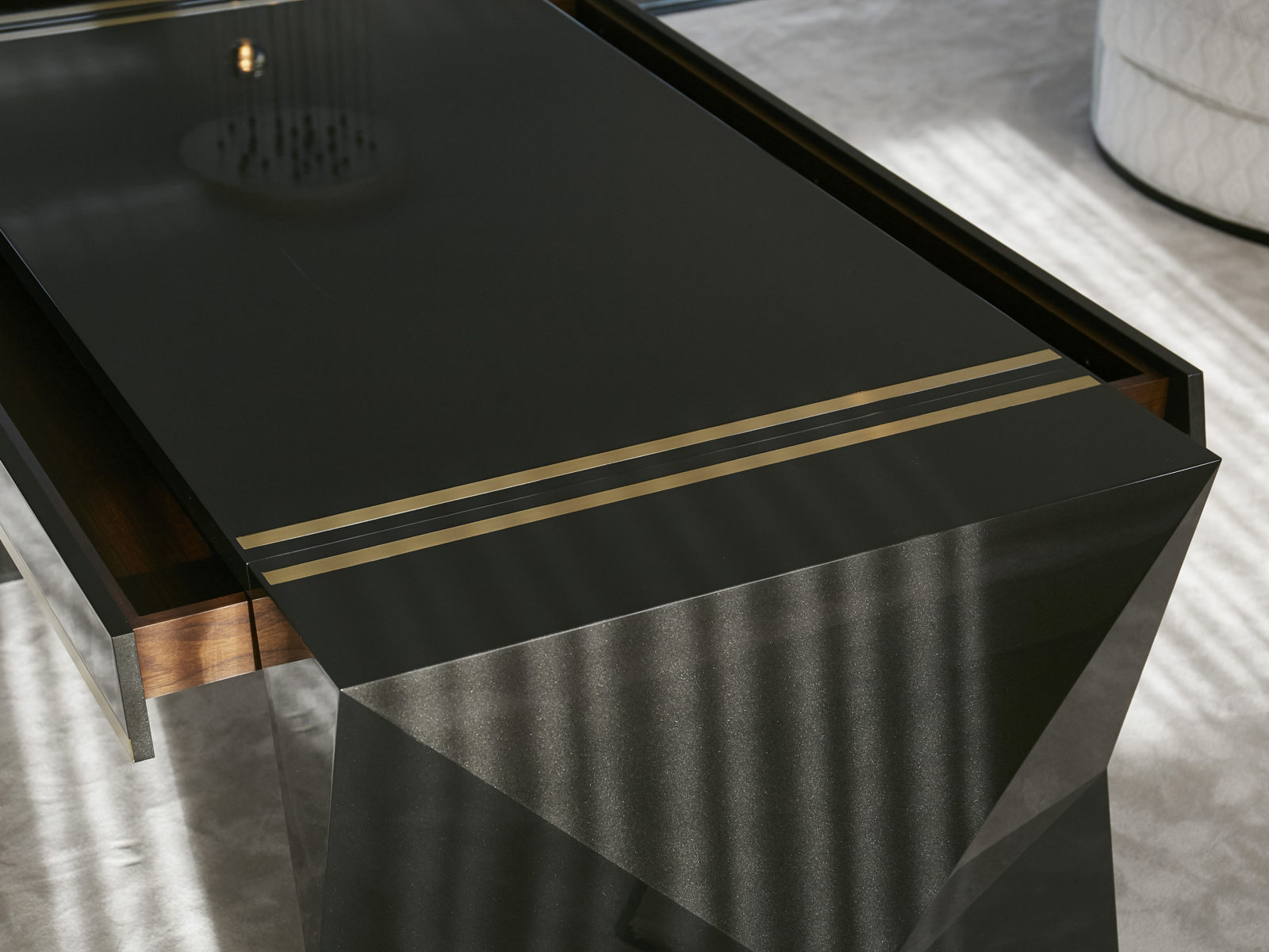 Lacquered gun metal desk with satin brass inlay and double ended walnut drawer