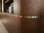 curved walnut veneer door and satin brass detail