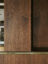 book matched walnut study cabinet with satin brass detail