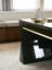 Gloss finish gun metal lacquered desk with satin brass drawer detail