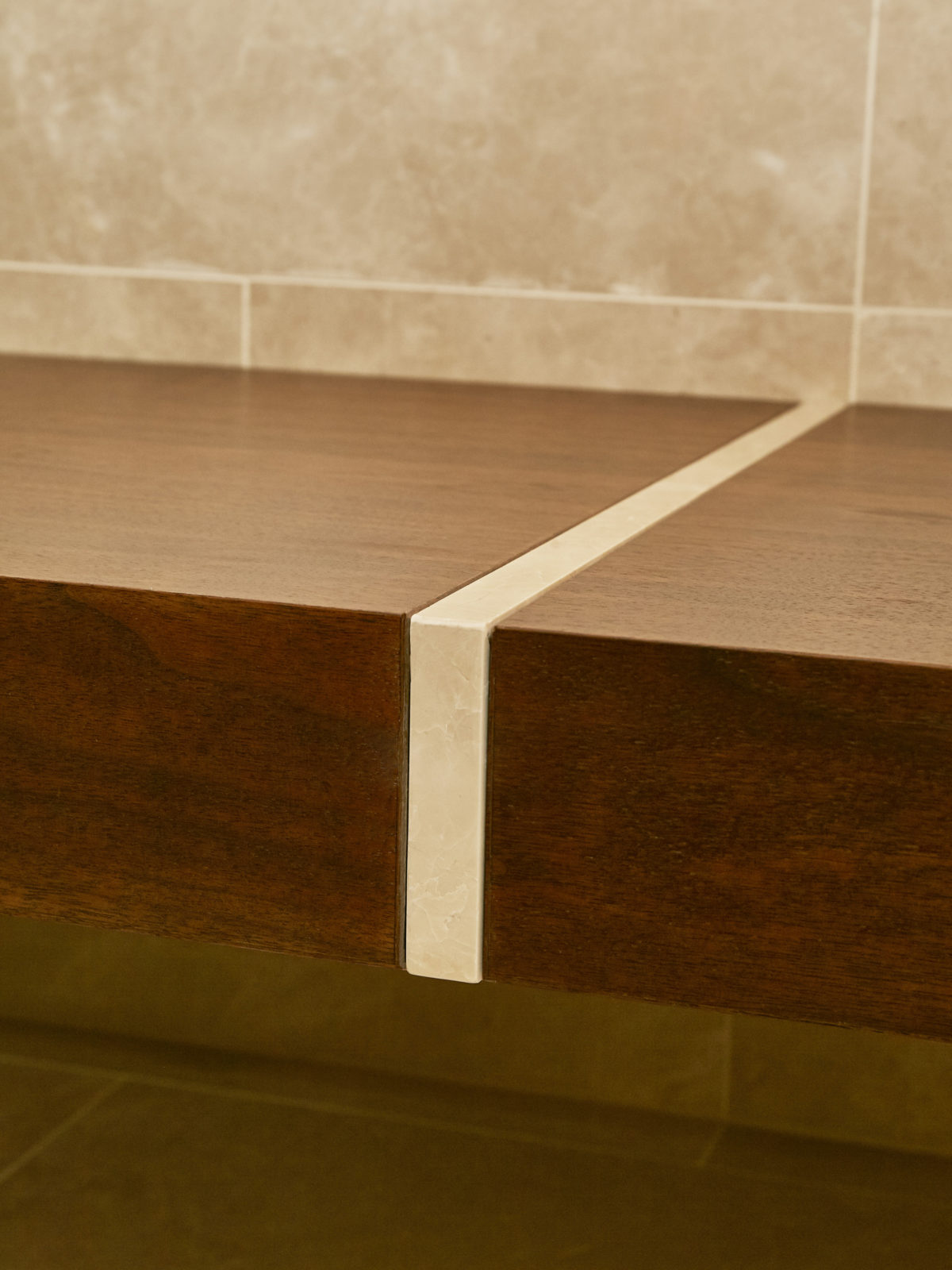 Walnut bench with marble inlay detail