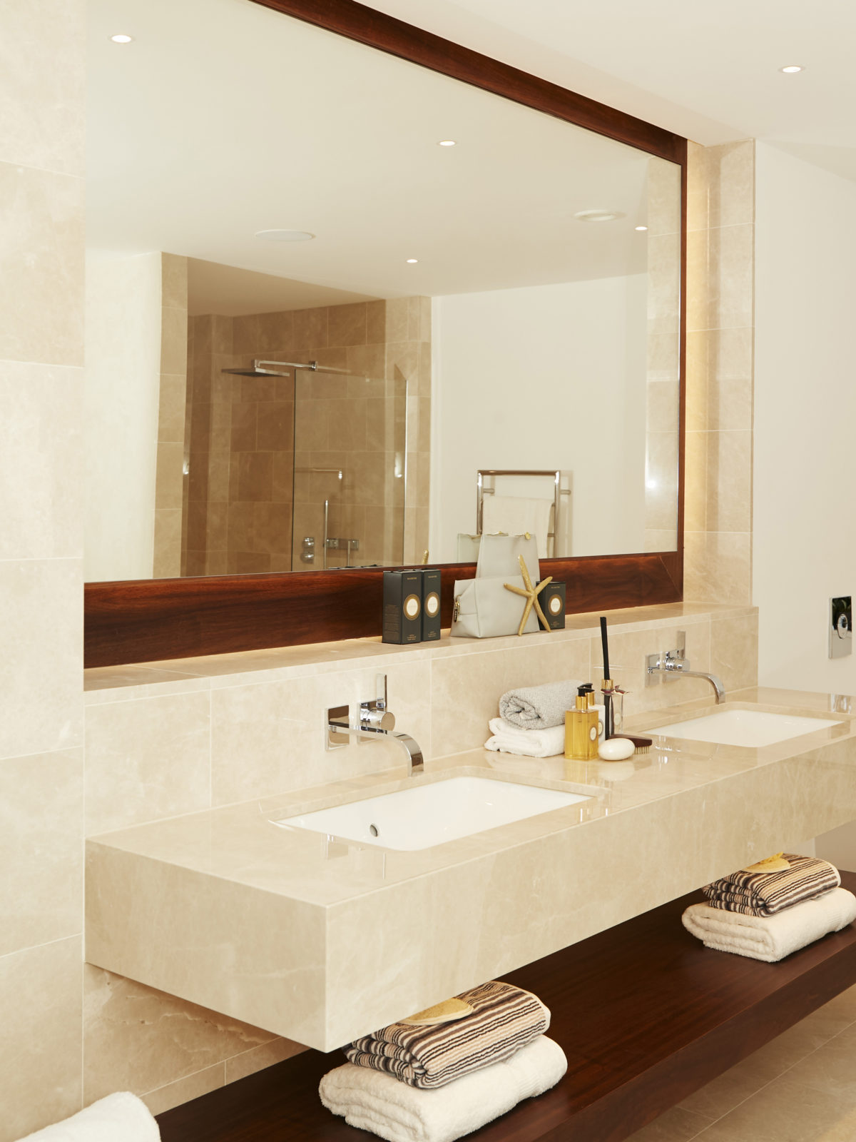crema classic marble bathroom with walnut mirror frame