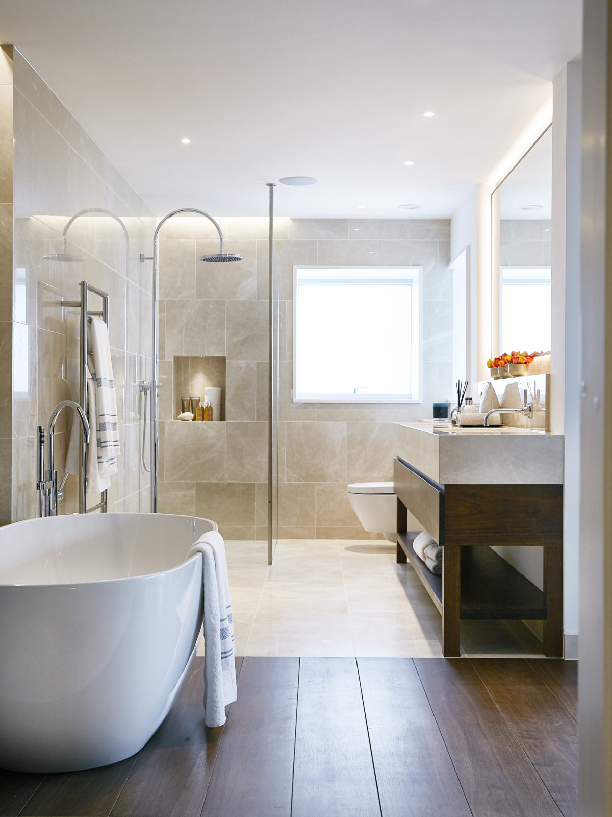 crema classic bathroom with walnut vanity unit and bathtub floor detail