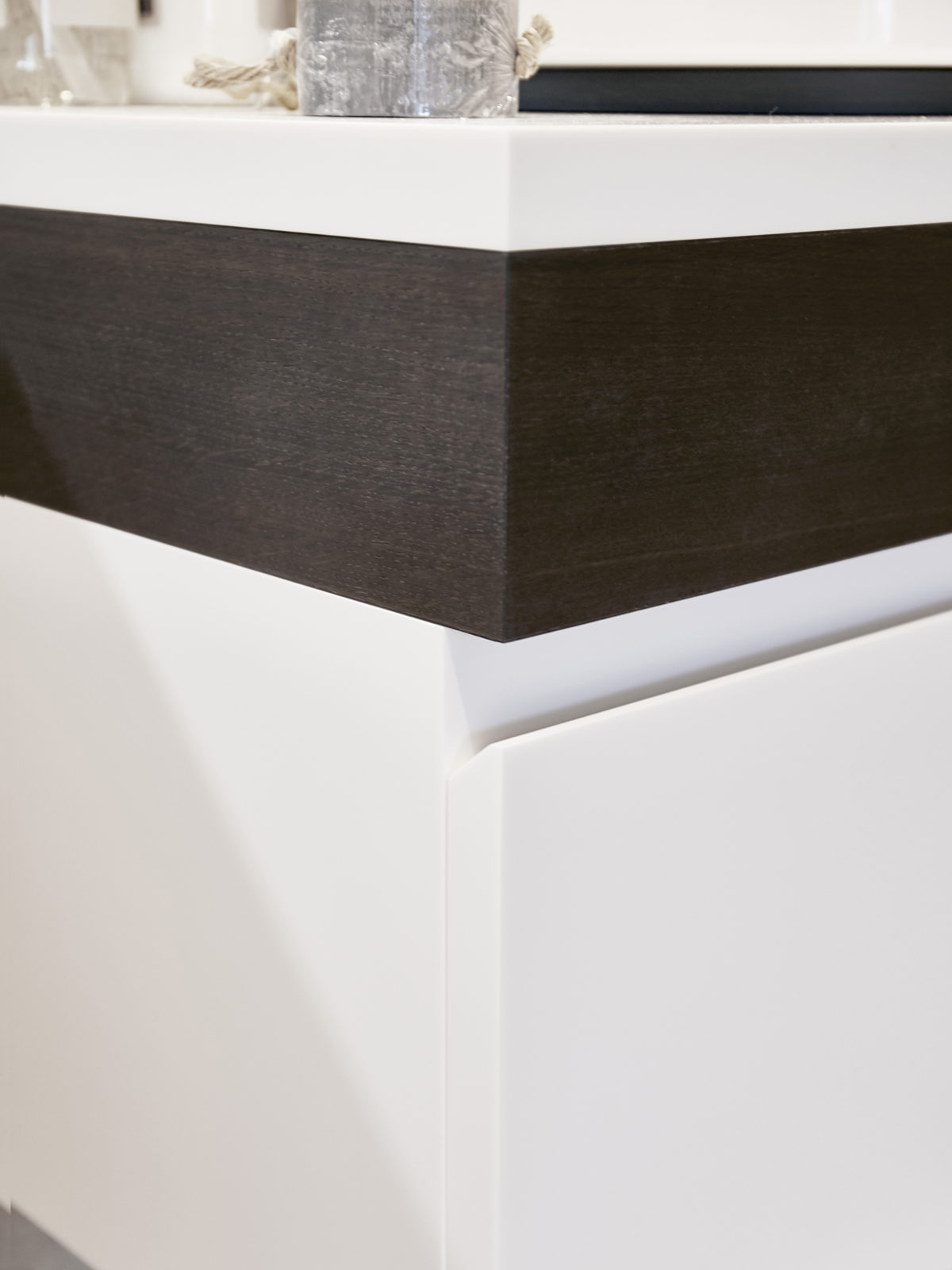 Corian handleless vanity unit with fumed oak strip detail