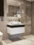 Moleanos limestone bathroom with white Corian and fumed oak vanity unit
