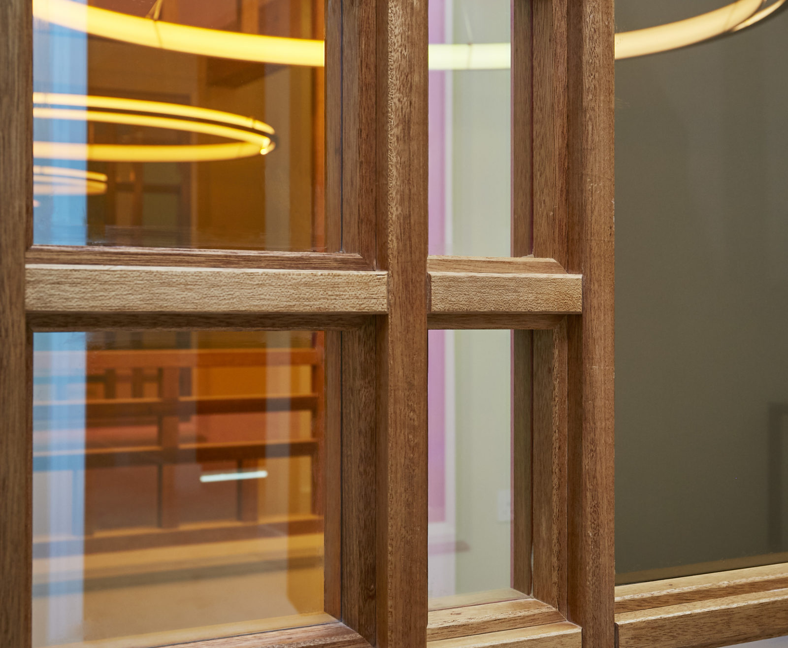 Dichroic glass windows with meranti frame detail