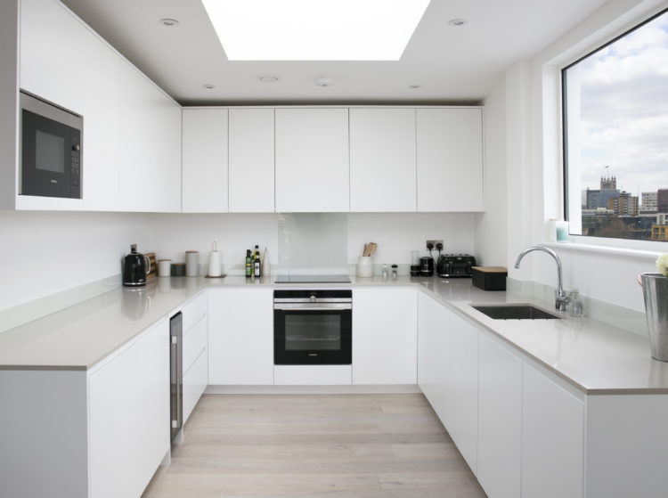 kitchen with matt white lacquered doors with Quartz worktop
