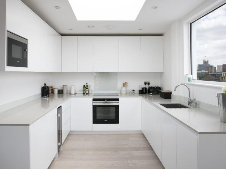 kitchen with matt white lacquered doors with Quartz worktop