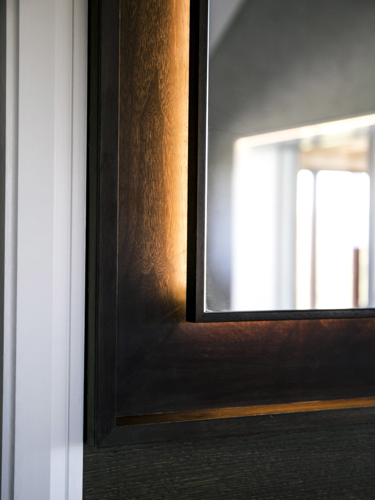 Fumed oak bathroom mirror with back lighting detail