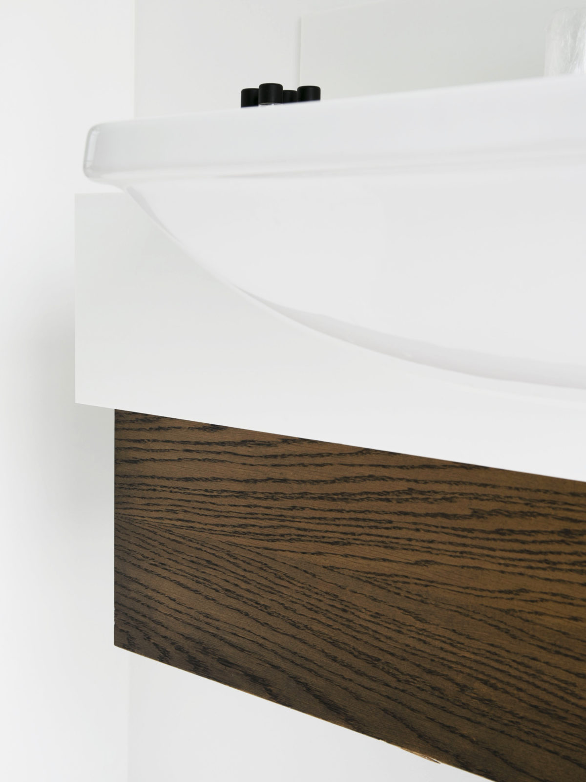 Oak vanity unit with Corian worktop