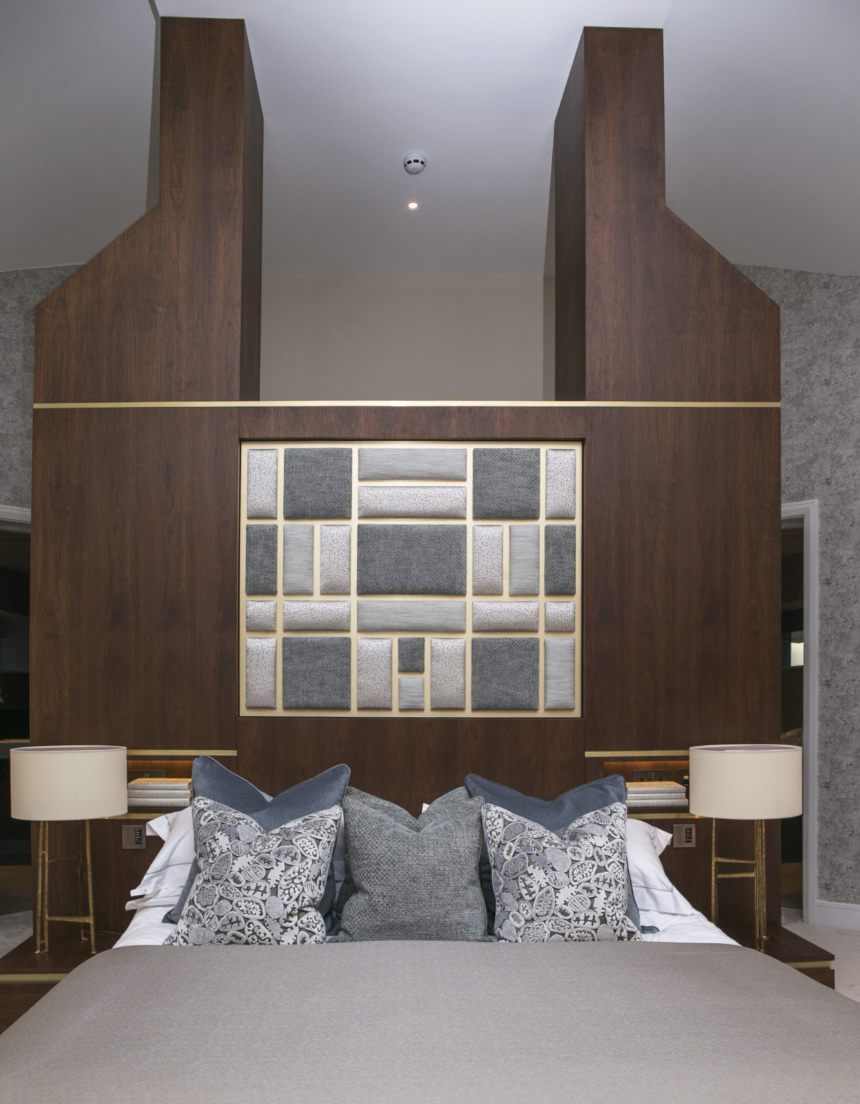 built in master walnut master bed with satin brass detail