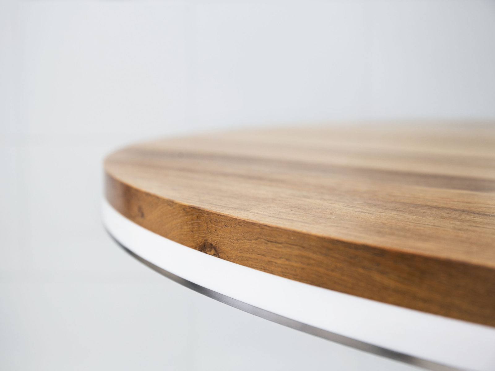 Teak, corian and steel dining table top detail