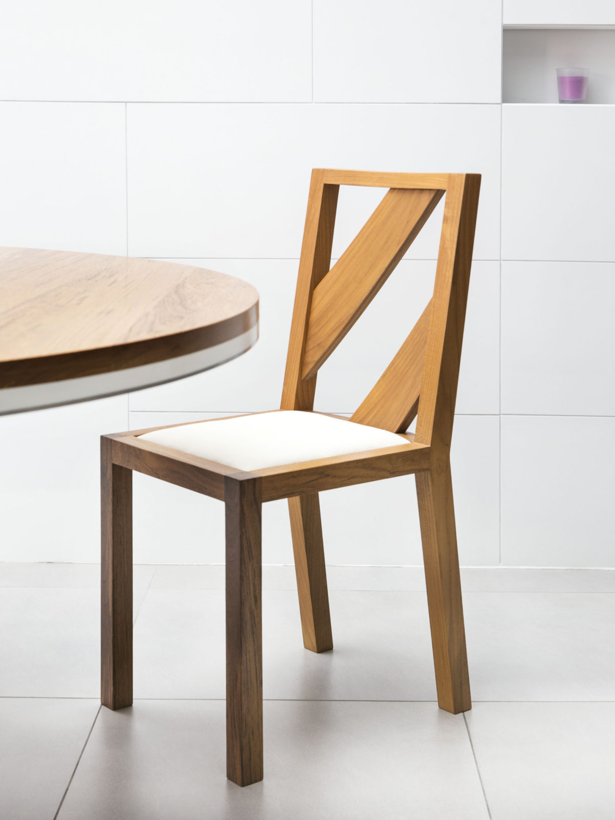 Solid teak chair with teak back strips and fabric seat