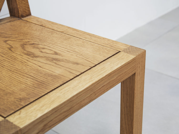 Solid oak chair seat close up