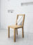 Solid oak chair with lacquered back strips