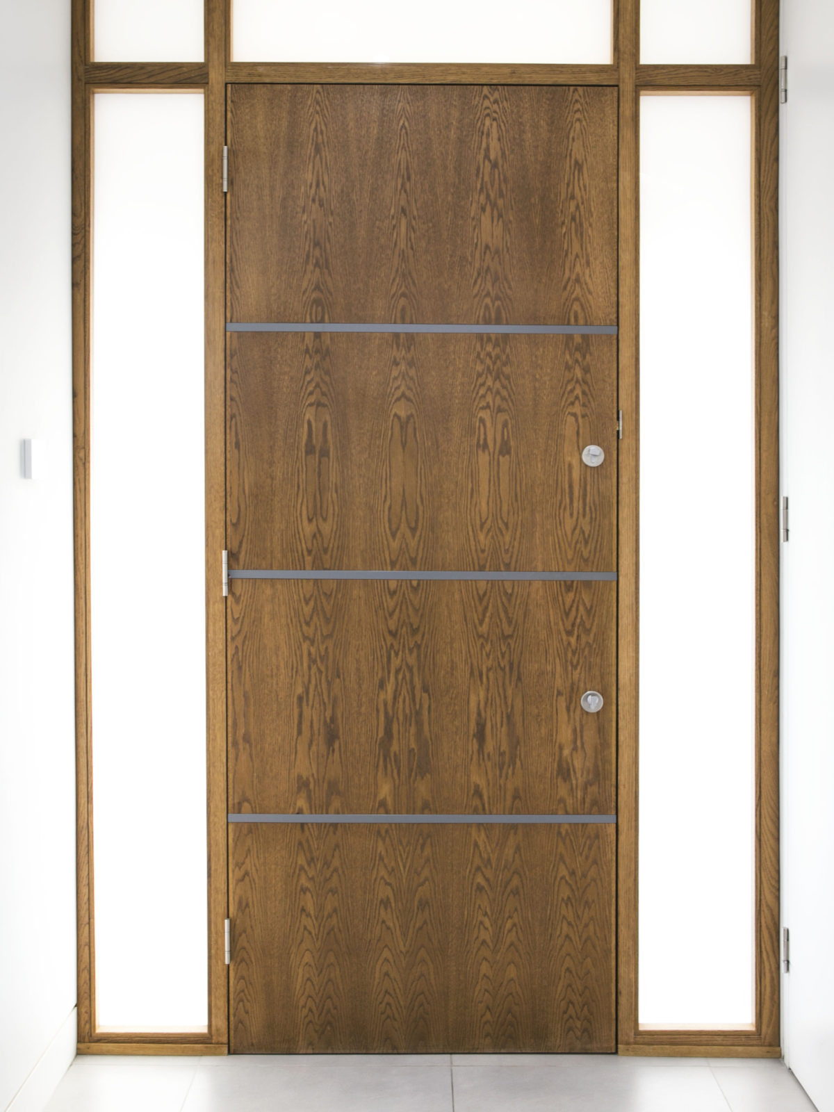 bespoke solid oak door with matt lacquered inlays