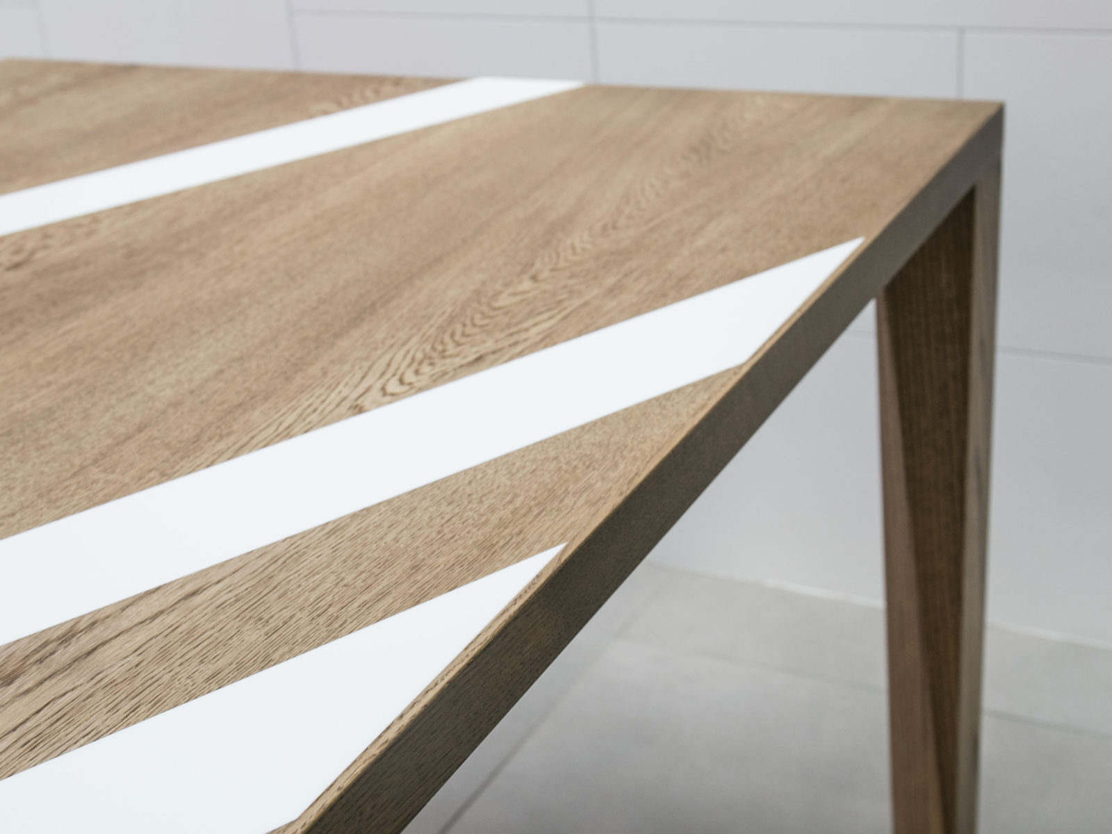 Oak dining table with white Corian inlays
