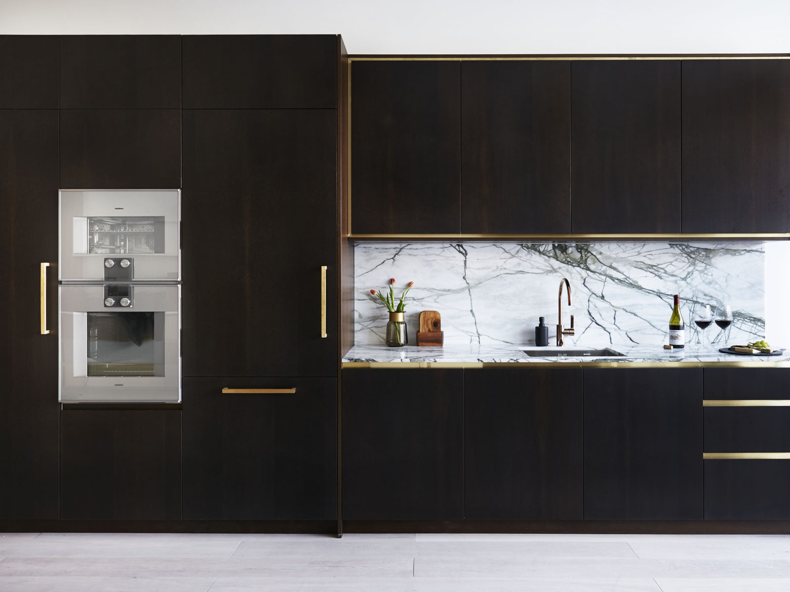 Fumed oak kitchen with Calacatta verde marble and satin brass detailing