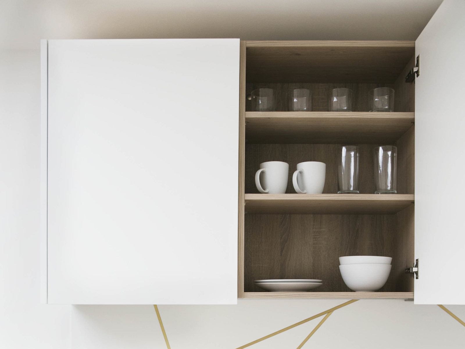 White matt lacquered kitchen unit with wood effect melamine carcass