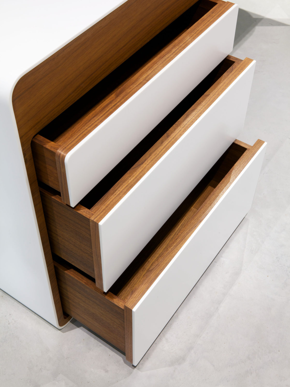 walnut drawers with Corian front