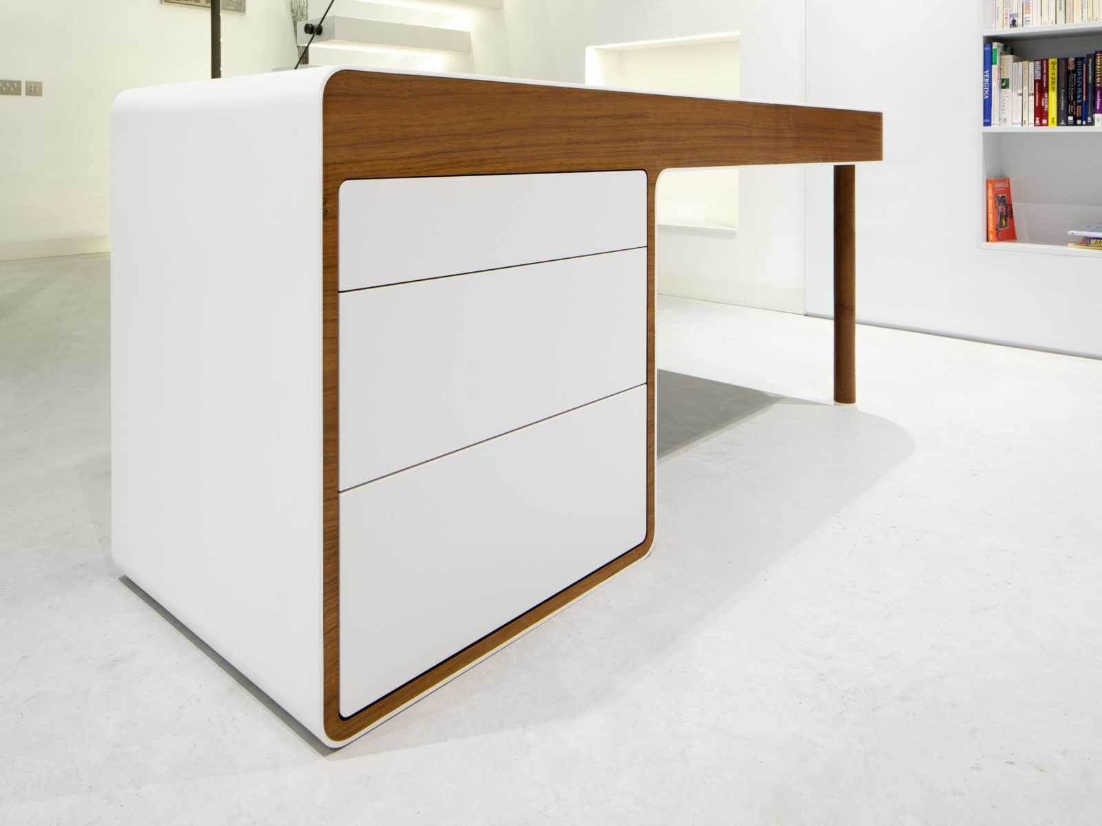 Corian curved desk with handleless drawers