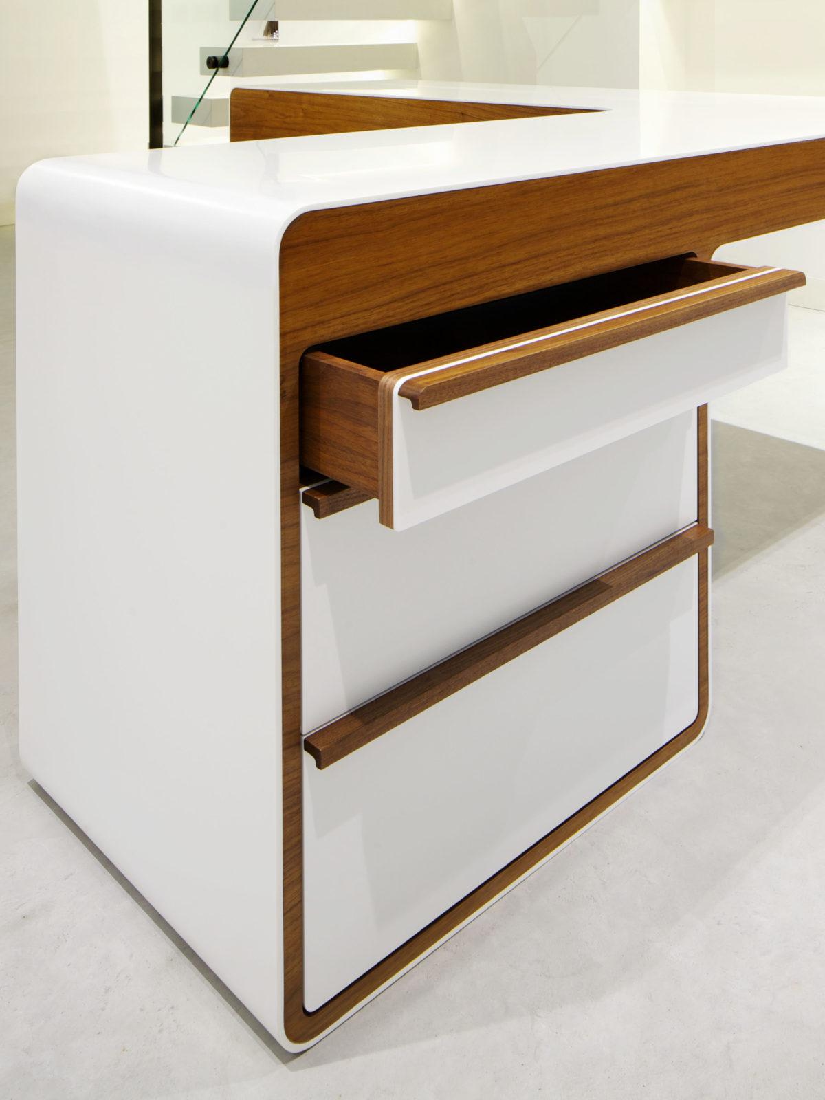 Corian desk with walnut drawer handle