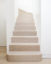 Limed oak staircase with rose gold inlay
