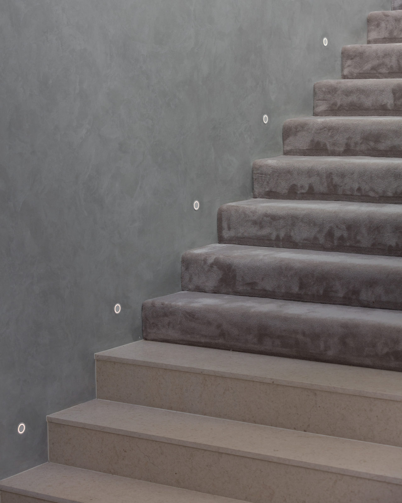 staircase with polished plaster walls