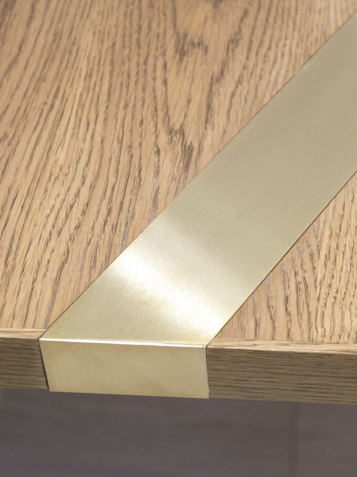 oak with satin brass inlay detail