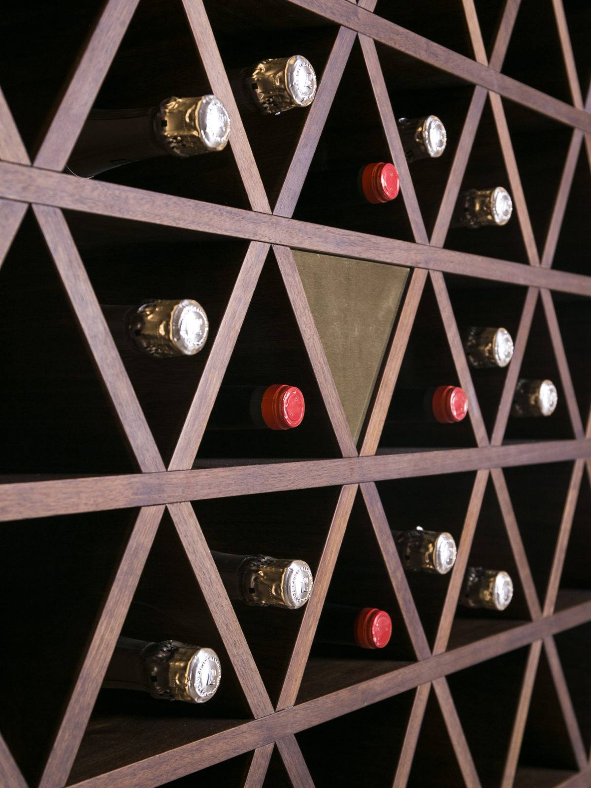 solid walnut feature wine rack wall with satin brass inserts