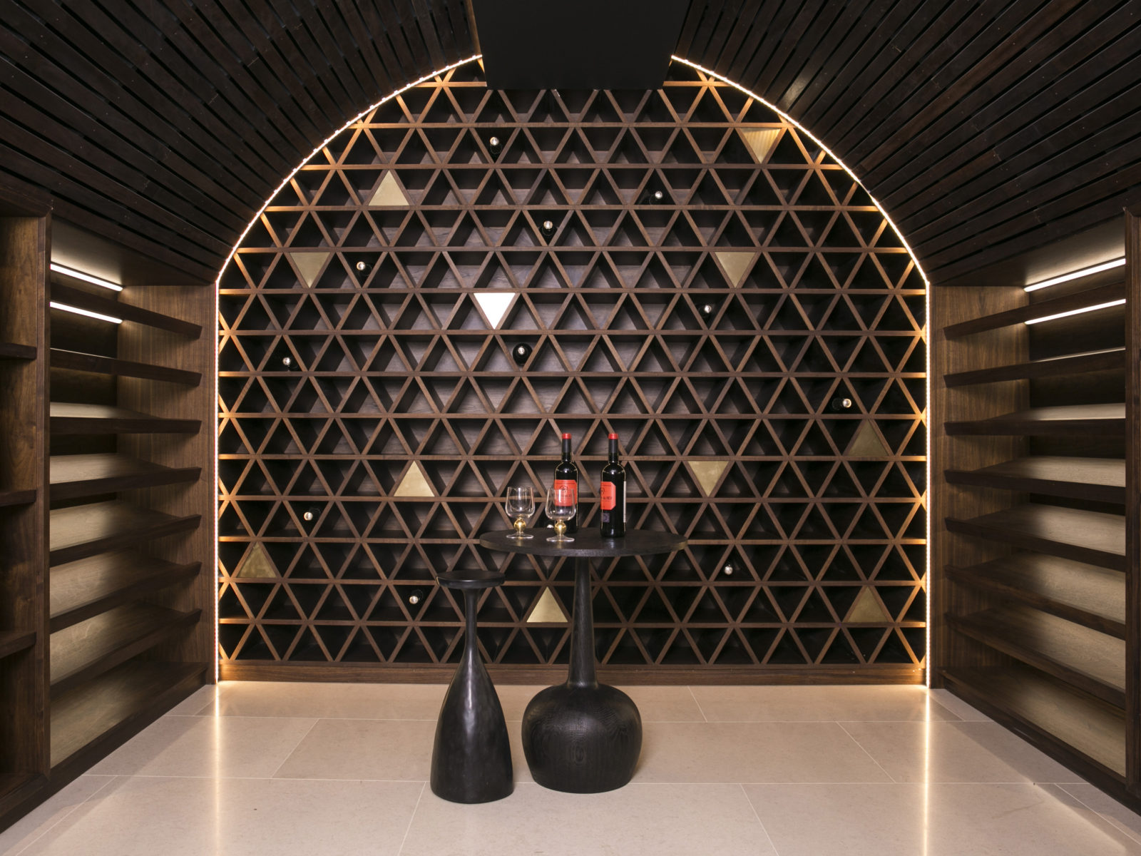 Solid walnut and satin brass bespoke wine cellar