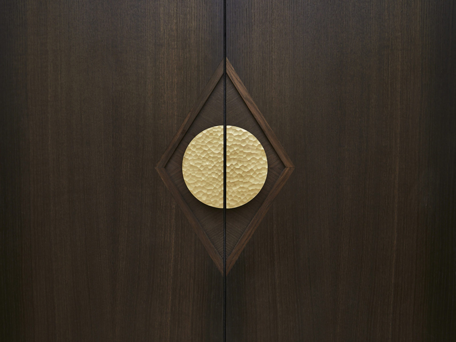 Bespoke fumed oak door with diamond motif and Ged Kennet handle