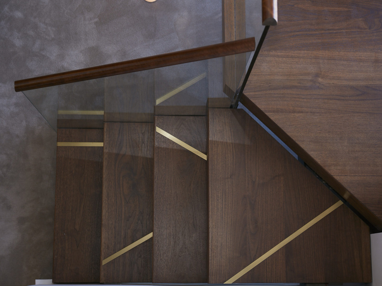 Solid walnut staircase with brass inlay