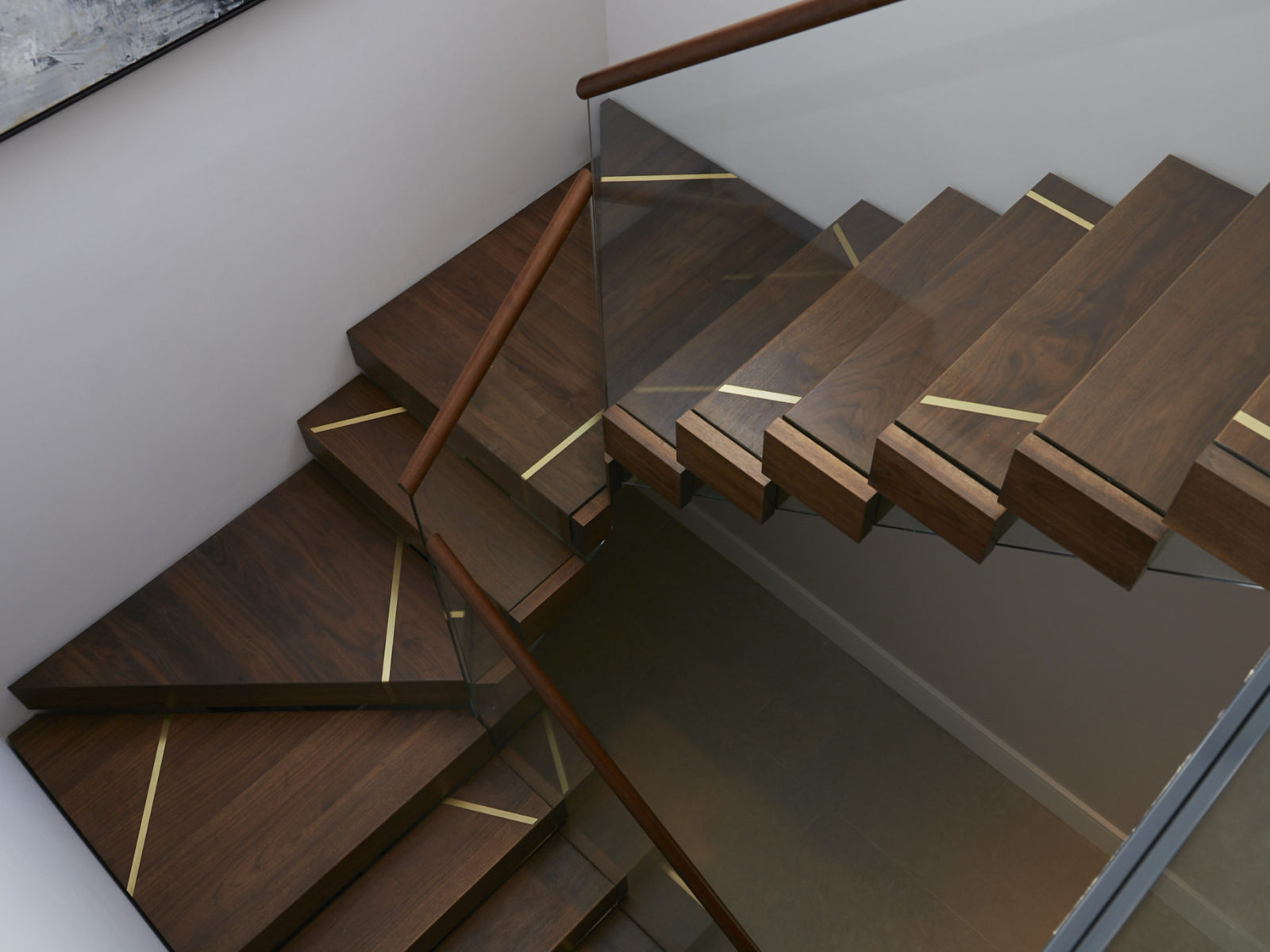 Solid walnut staircase with brass detailing